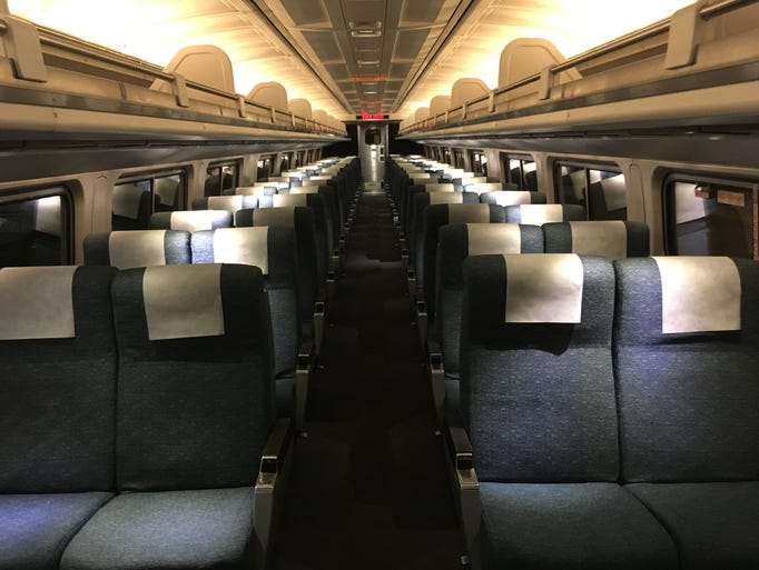 amtrak updates rail car interiors. Black Bedroom Furniture Sets. Home Design Ideas