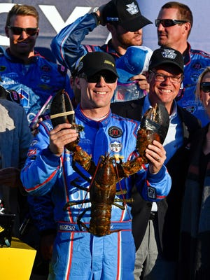 Kevin Harvick celebrates with the traditional lobster given to the winner at New Hampshire Motor Speedway.