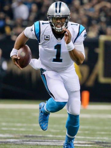 Carolina Panthers quarterback Cam Newton (1) runs with