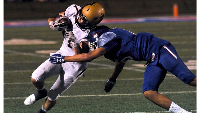 Eagle's wide receiver Wes Berry takes a hit on the shoulder pad from Cooper High School defensive back Dylon Davis during Friday's crosstown showdown at Shotwell Stadium Friday Sept. 15, 2017. The Cougars beat Abilene High School, 49-35.