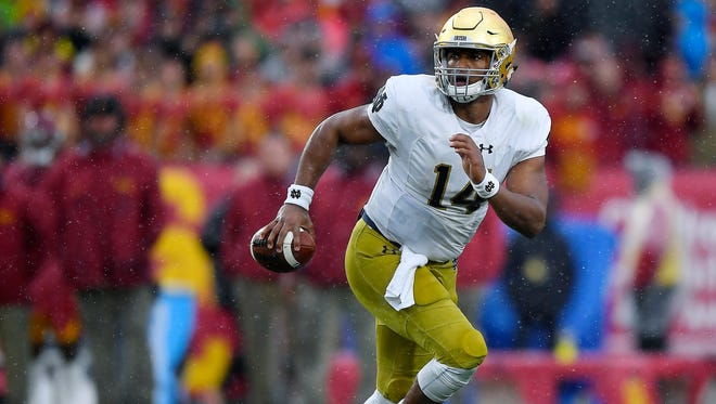 Quarterback DeShone Kizer posted a 12-11 record in 23 starts over two seasons at Notre Dame.