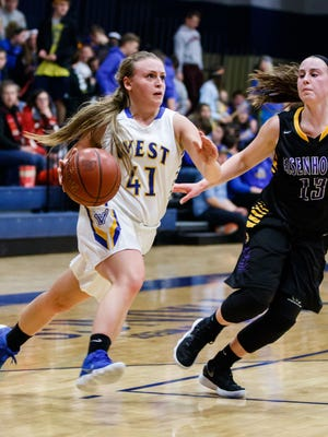 New Berlin West senior Lauren Kunz (41) makes a run from the corner during the game at home against New Berlin Eisenhower on Tuesday, Jan. 23, 2018.
