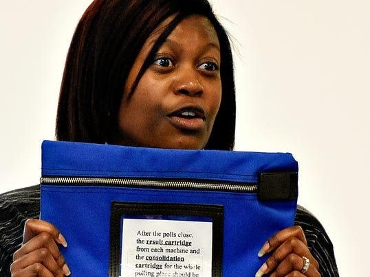 York County Elections and Voter Registration Director Nikki Suchanic emphatically talks to poll workers about the importance of the official voting machine cartridge bag during a training session at the Red Lion Area Senior Center in Red Lion, Pa. on Tuesday, Oct. 20, 2015. Dawn J. Sagert - dsagert@yorkdispatch.com