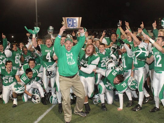 Rob Dahl, shown holding the NJSIAA Central Group IV football championship plaque in 2013.