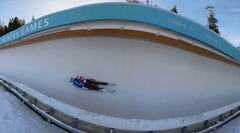 Speed down an ice tunnel on a luge sled in VR