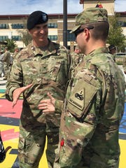 Col. Eric S. Strong greets well-wishers after assuming