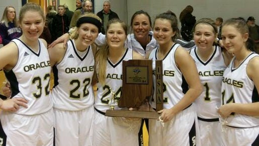 Delphi's seniors celebrate the school's first girls basketball sectional since 1996.