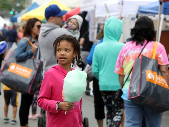 With cotton candy in hand, Lilia Kyle of Nanuet, 9,
