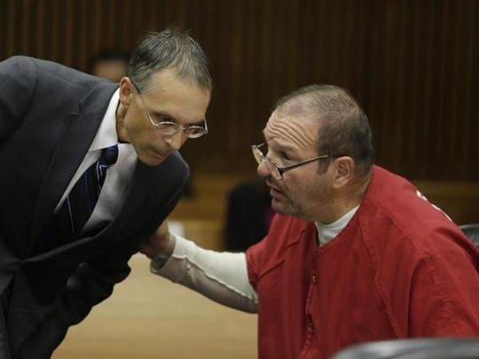 Bob Bashara, right, speaks to his attorney, Ronald Ambrose in court Tuesday, Sept. 15, 2015.