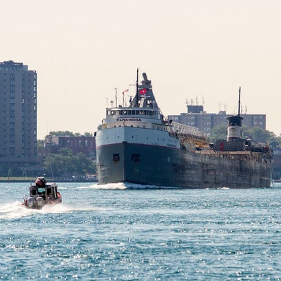A U.S. Coast Guard boat approaches a freighter in August