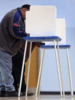 Men at voting machines, 2010
