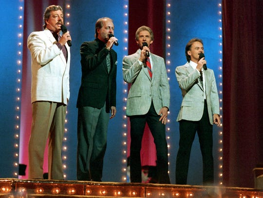 Country music singing group The Statler Brothers perform