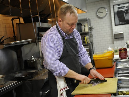 Chef Andy Little works in his kitchen at Josephine