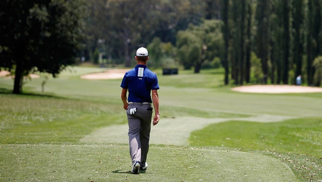 Brandon Stone walks down the fairway after he hits his tee shot on the third hole during at the Joburg Open.