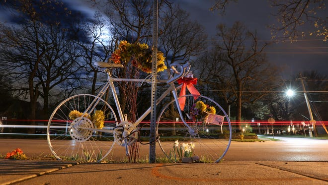 A memorial to Wade Franck, a well-known Des Moines cyclist, sits near the spot Franck was hit by a drunk driver on Grand Avenue in Des Moines. Franck died as a result of injuries sustained in the accident two days later.