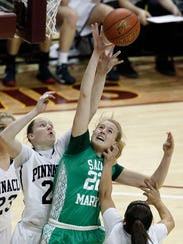 Phoenix St. Mary's Courtney Ekmark fights for a rebound