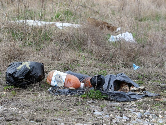 Some people don't go very far into the country to dump their trash. This garbage was dumped on Leipsic Road in the shadow of the Dover International Speedway.