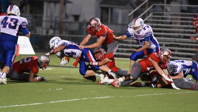 SJCC's Israel Ysasi makes a tackle Saturday against Danville as Nate Burns makes sure.