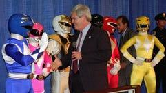 House Speaker Newt Gingrich of Ga. prepares to shake
