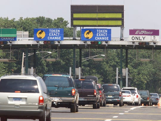 Traffic proceeds through a toll plaza on the Garden State Parkway.