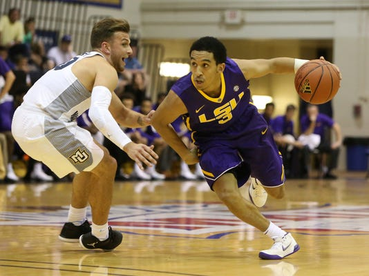 LSU guard Tremont Waters (3) tries to get around Marquette guard Andrew Rowsey (30) during the first half of an NCAA college basketball game, Wednesday, Nov. 22, 2017, in Lahaina, Hawaii. (AP Photo/Marco Garcia)