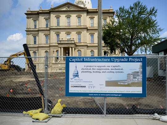 A sign on the south side of the state Capitol on Wednesday, Aug. 16, 2017 explains the infrastructure project for which workers are now preparing to install a geothermal system and underground central utility plant.