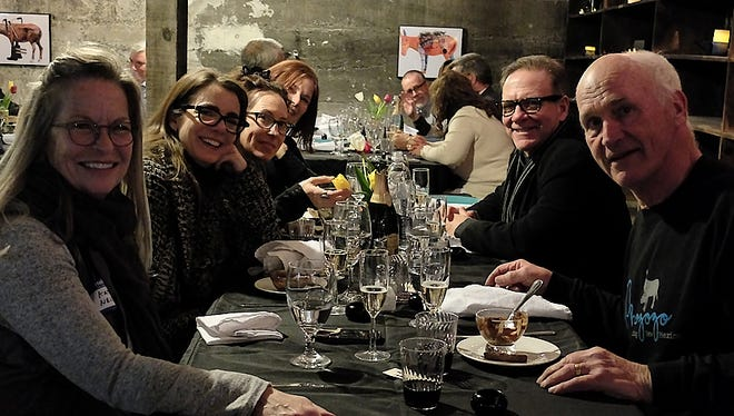 Tularosa Basin Gallery owner Warren Malkerson, right, dines at a Friday photography gala with New Mexico Magazine editor-in-chief Dave Herndon, second from right, and (l-r) Kate Nelson, managing editor; Edie Dillman, art and photography director; Gabriella Marks, president of the American Society of Media Photography, New Mexico; and Laura Shields, account executive for the magazine.