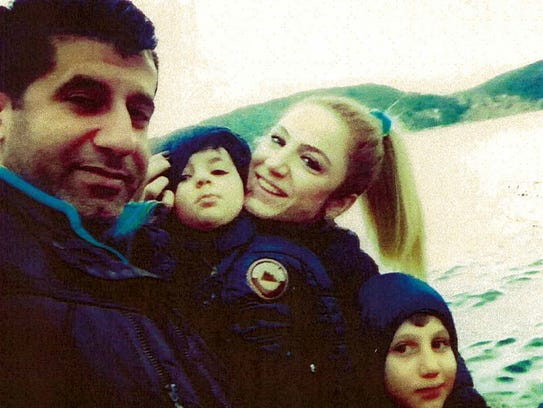 Resit Tavan, his wife, Arzu, and their two sons. They