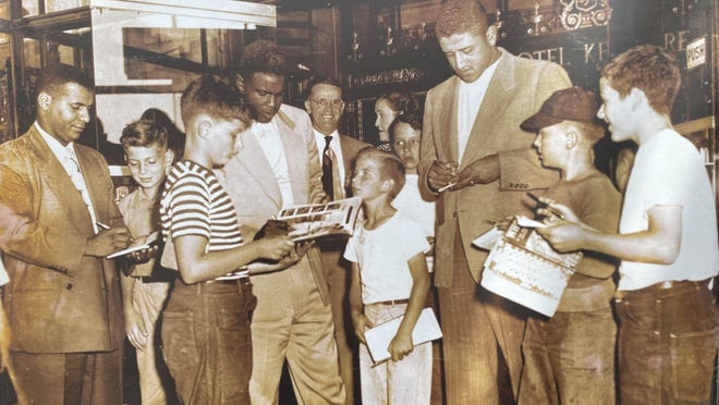 Even as a child, Steve Adamson of Stoughton, right, was a collector. He is seen here getting the autographs of several Dodgers players in the lobby of the Hotel Kenmore in Boston in 1949.  Submitted photo