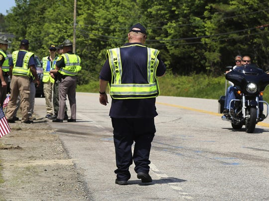 Members of the National Transportation Safety Board and the New Hampshire State Police investigate the scene of Friday's collision involving a pick-up truck and numerous motorcycles in Randolph, N.H., Sunday, June 23, 2019. (Peter Knudson/National Transportation Safety Board via AP)