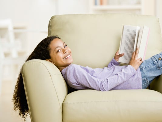 Mixed Race girl reading