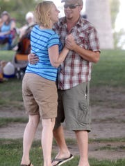 Jenny Coe and David Stacy dance in a crowded Young Park while enjoying mariachi music during the city's free Music in the Park series.