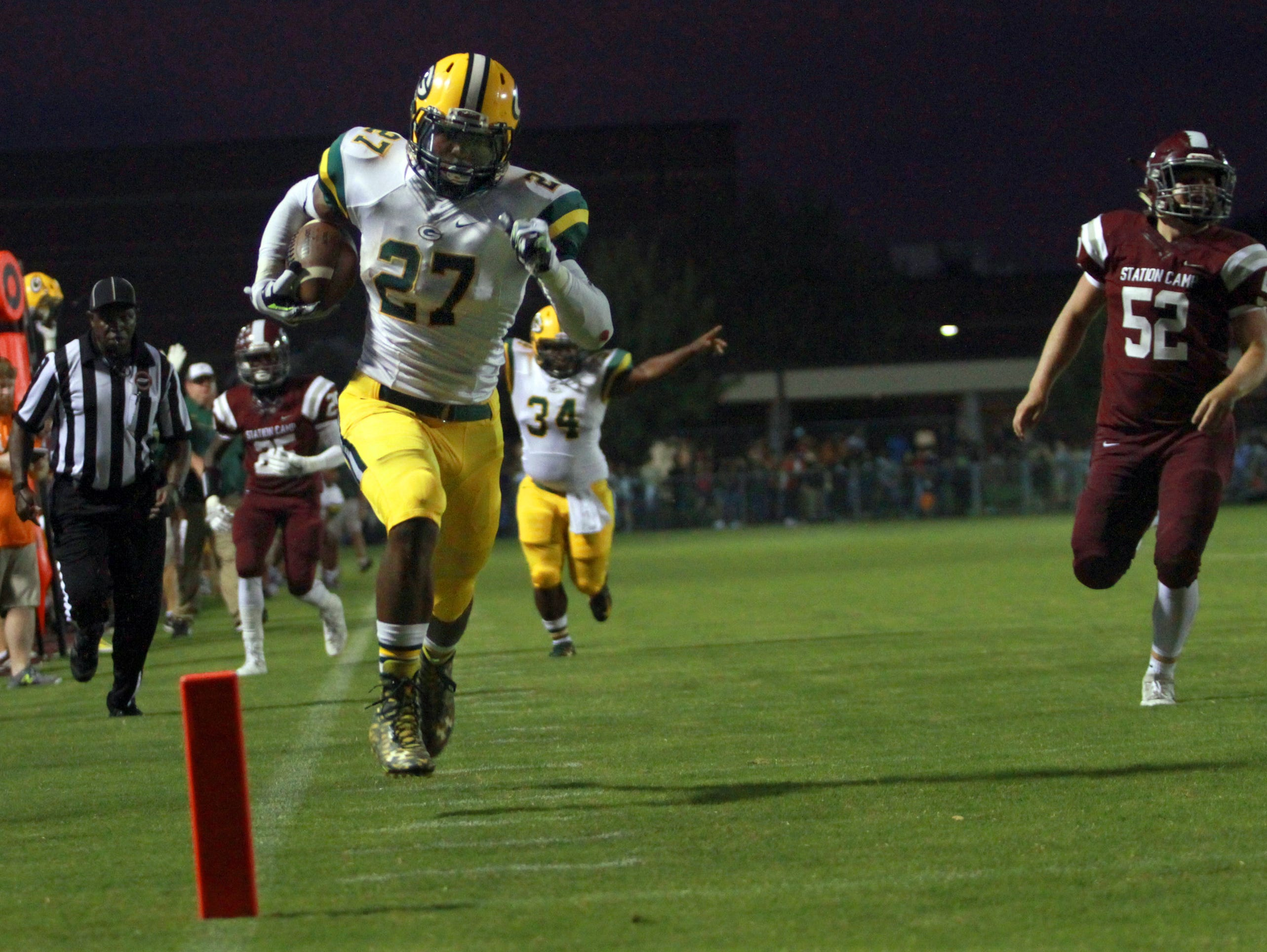 Gallatin running back Jordan Mason rumbles into the endzone, leaving Station Camp's Simon Freeman behind. Mason scored three touchdowns in the Green Wave's 34-27 victory on Sept. 23.
