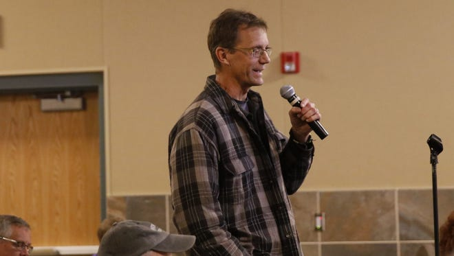 Farmington resident and solar user Paul Pavlik talks Wednesday about the proposed rate changes for the Farmington Electric Utility System during a public meeting at the Farmington Civic Center.