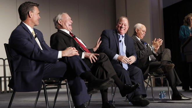 Macomb County Executive Mark Hackel, from left, Oakland County Executive L. Brooks Patterson, Detroit Mayor Mike Duggan and Wayne County Executive Warren Evans at the Detroit Economic Club meeting held Jan. 20 at Cobo Center in Detroit.