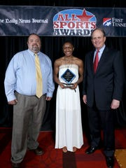 The Daily News Journal prep editor Tom Kreager, left, stands with Female Athlete of the Year Crystal Dangerfield and First Tennessee President Phil Holt at the 22nd annual All Sports Awards banquet in Murfreesboro.