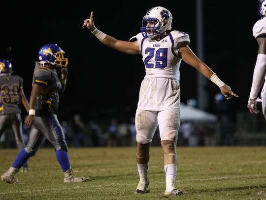 Godby's Kyler Laing signals at the sidelines after a defensive stop against Rickards during their game at Cox Stadium on Friday night.