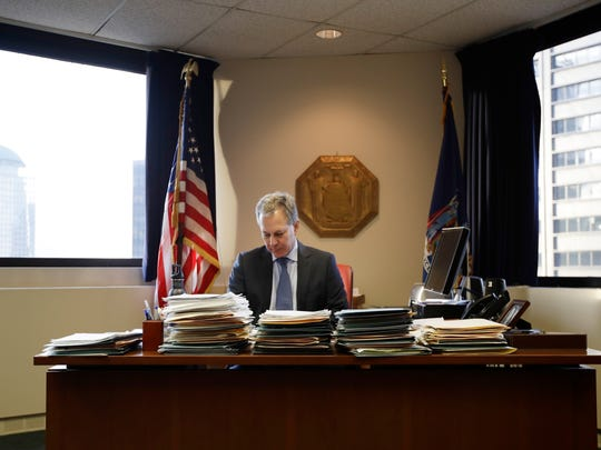 FILE - In this Friday, Feb. 17, 2017, file photo, New York State Attorney General Eric Schneiderman sits at his desk in his office in New York. Schneiderman, who had taken on high-profile roles as an advocate for women's issues and an antagonist to the policies of President Donald Trump, announced late Monday, May 7, 2018, that he would be resigning from office hours after four women he was romantically involved with accused him of physical violence in accounts published by The New Yorker.