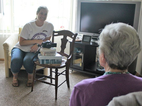 Mara Wilson, the life enrichment coordinator at Primrose Retirement Community, records resident Phyllis Peters as she shares some memories.