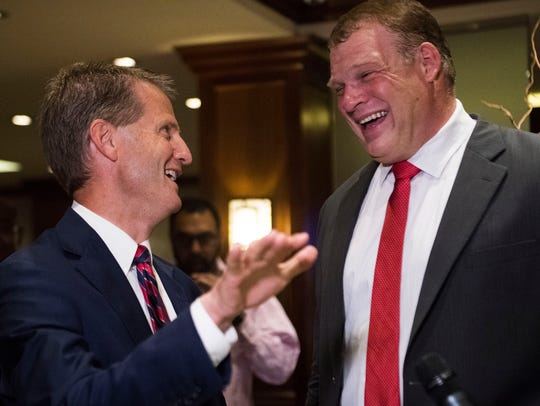 Tim Burchett speaks to then-Knox County Mayor-elect Glenn Jacobs at the Crowne Plaza on election day in Knox County Thursday, Aug. 2.