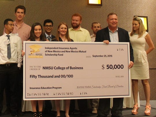 NMSU professor Tim Query, second from right, and students in the Risk Management and Insurance Studies Program accept a $50,000 gift from Independent Insurance Agents of New Mexico and New Mexico Mutual at an event last fall. The gift has been used to fund an endowed scholarship and fund the program, a minor in the College of Business Department of Finance.