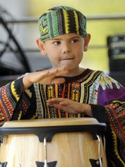 Garrett Pagel plays along with the Two Rivers High School band's hand-drumming ensemble during a previous Ethnic Fest in Two Rivers.