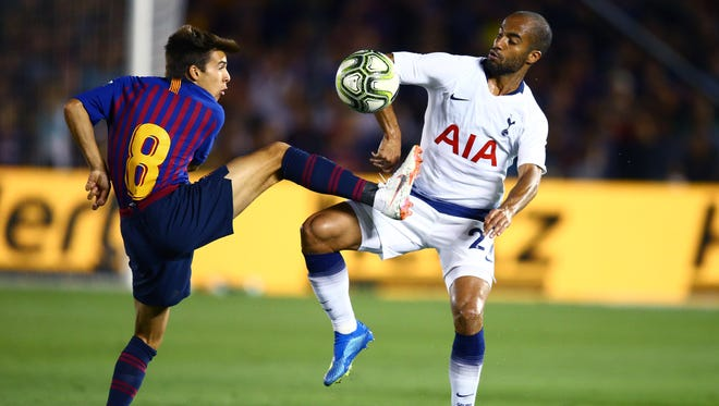 Top teams from the Union of European Football Associations are playing matches in the United States in the International Champions Cup. FC Barcelona's  Ricard Puig (8) battles for the ball against Tottenham Hotspur's Lucas Moura (27) during a game Saturday at the Rose Bowl in Pasadena, California. Both teams are in action again Tuesday night in matches that will be televised by ESPN, ESPN2 and ESPNews.