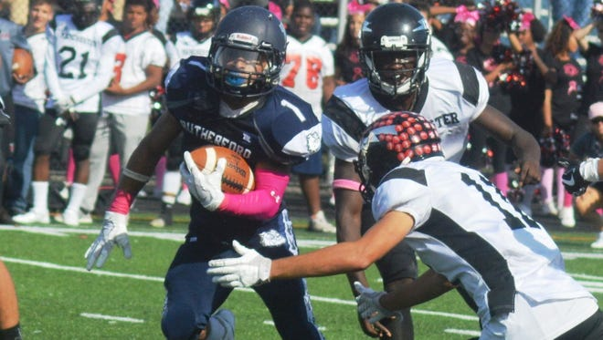 Rutherford running back Abellany Mendez (1) had 12 carries for 147 yards against Manchester.