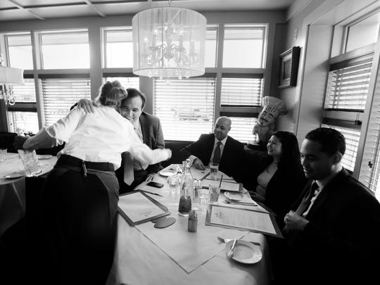 Cranley gets a hug from a server who grew up with him