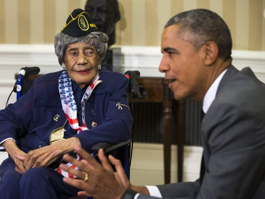 President Barack Obama meets with 110-year-old Emma Didlake, believed to be the nation's oldest living veteran, in the Oval Office.