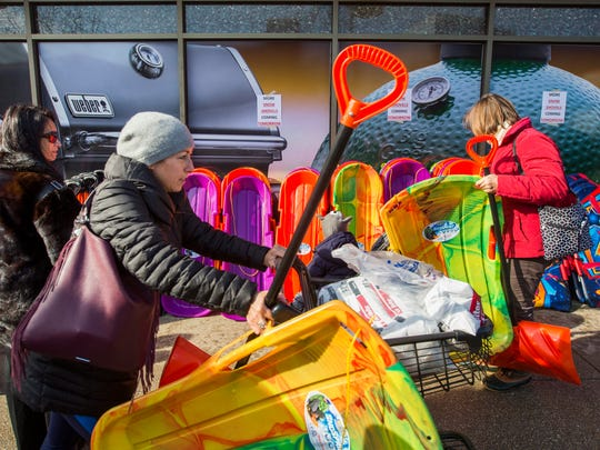 Shoppers stock up on snow shovels and other supplies