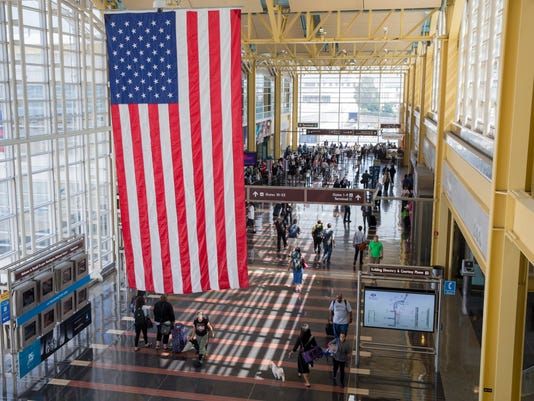People travel ahead of the Independence Day weekend at Ronald Reagan Washington National Airport
