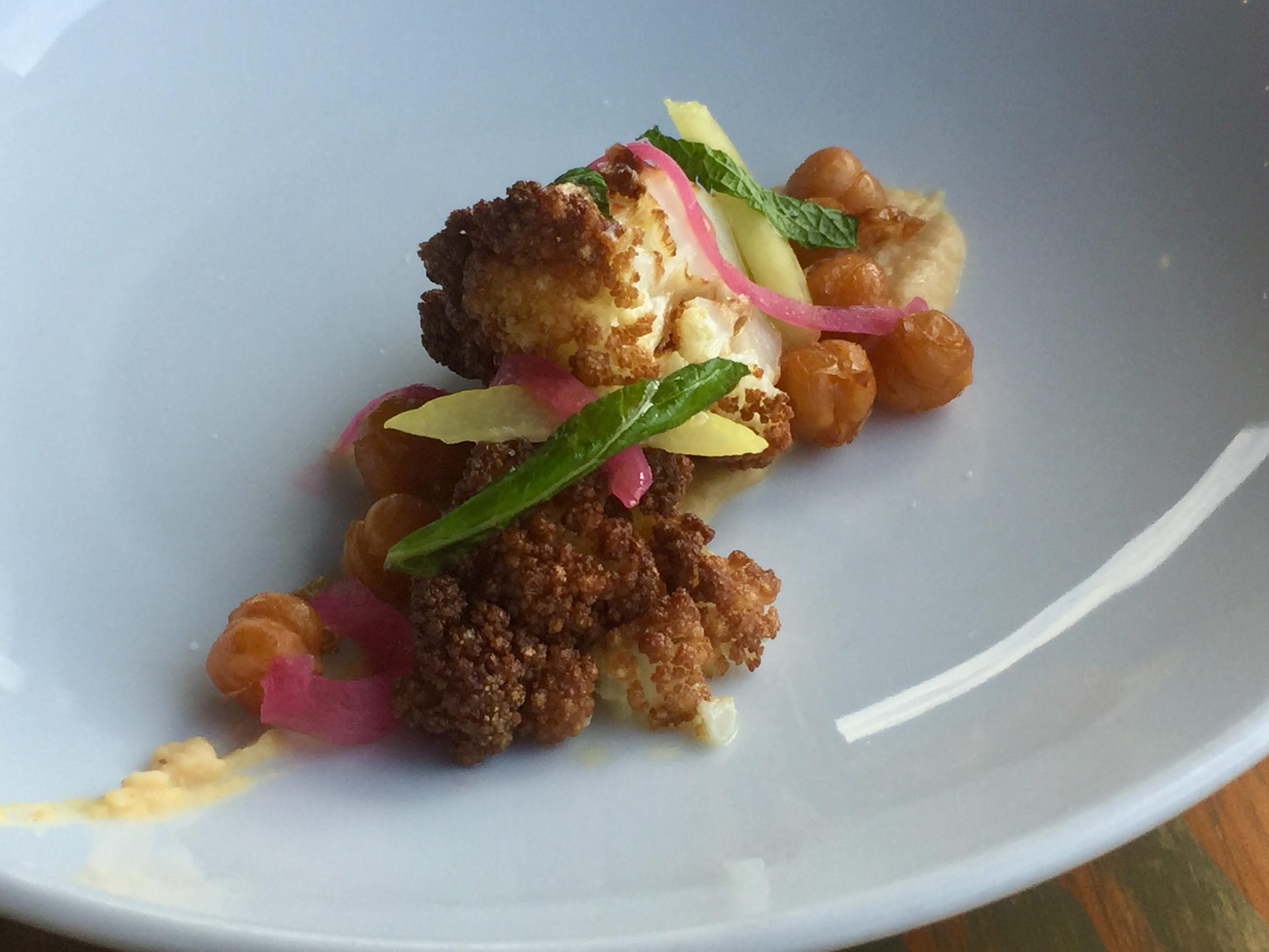 The new menu at Midtown Eats features roasted cauliflower