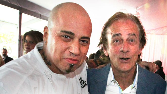 Chef Vic Vegas Moea and IndyCar driver Arie Luyendyk at the 2014 Rev bash. Moea is back for this year's May 2 event.